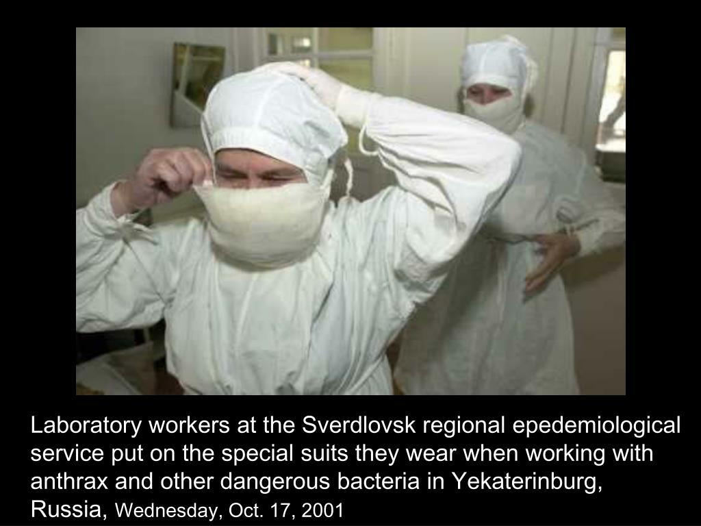 Laboratory workers at the Sverdlovsk regional epedemiological service put on the special suits they wear when working with anthrax and other dangerous bacteria in Yekaterinburg, Russia,