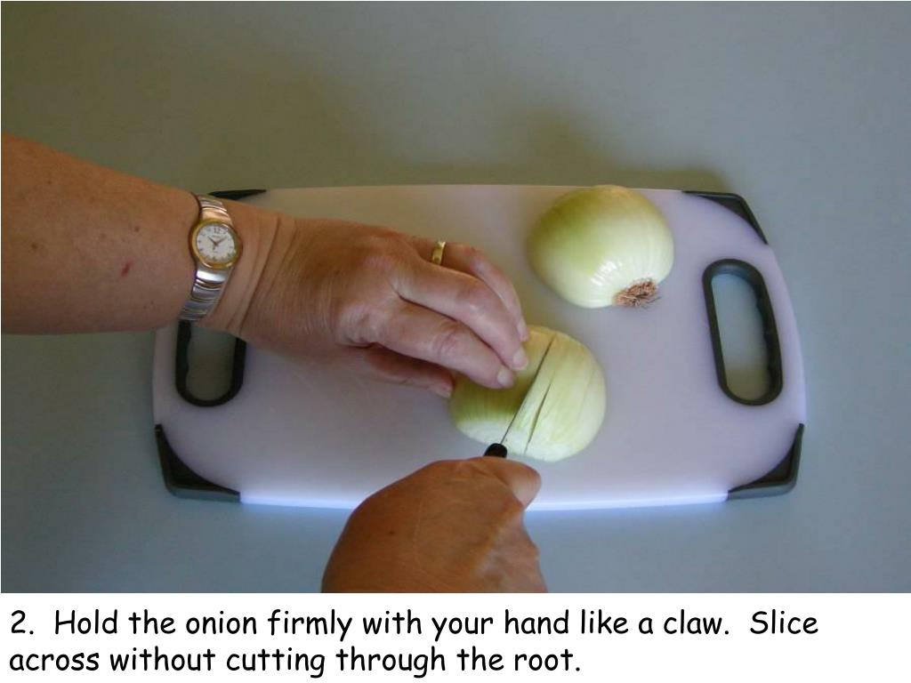 2.  Hold the onion firmly with your hand like a claw.  Slice across without cutting through the root.