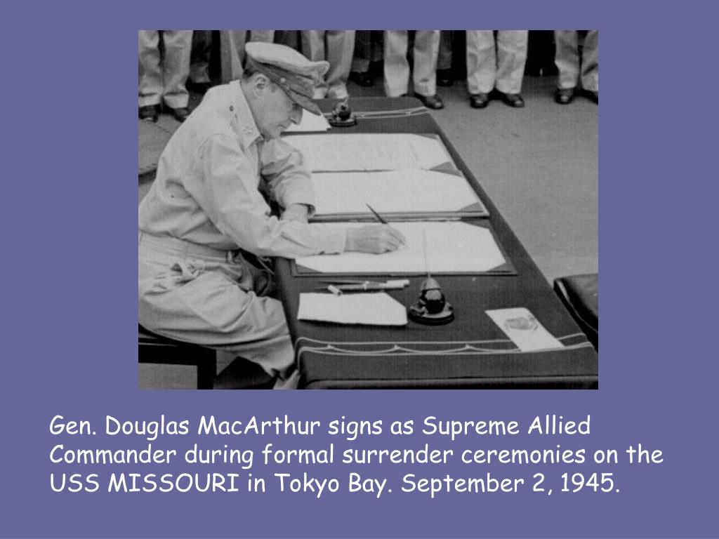 Gen. Douglas MacArthur signs as Supreme Allied Commander during formal surrender ceremonies on the USS MISSOURI in Tokyo Bay. September 2, 1945.