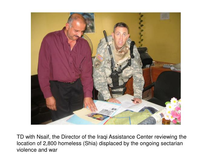 TD with Nsaif, the Director of the Iraqi Assistance Center reviewing the location of 2,800 homeless ...