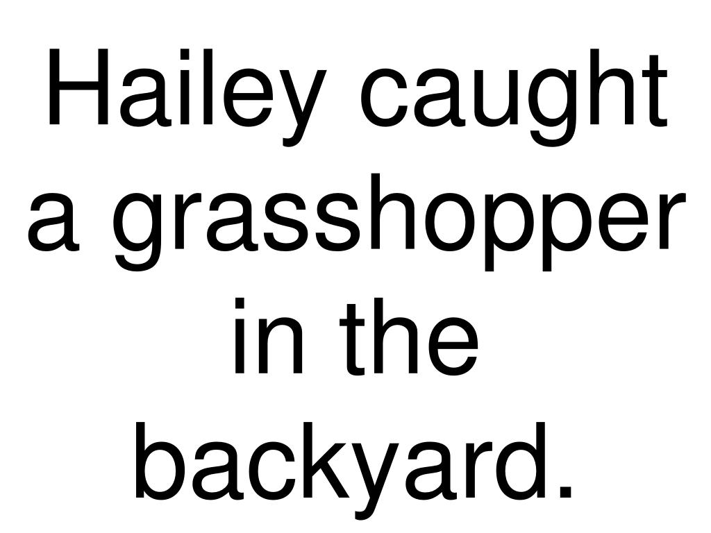 Hailey caught a grasshopper in the backyard.