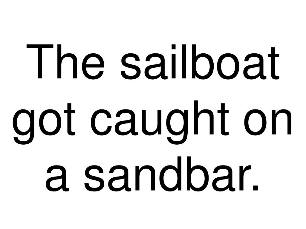The sailboat got caught on a sandbar.