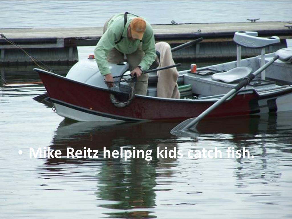 Mike Reitz helping kids catch fish.