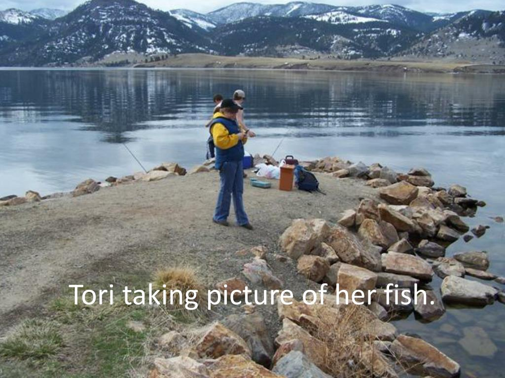 Tori taking picture of her fish.