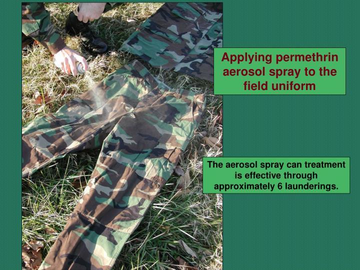 Applying permethrin aerosol spray to the field uniform