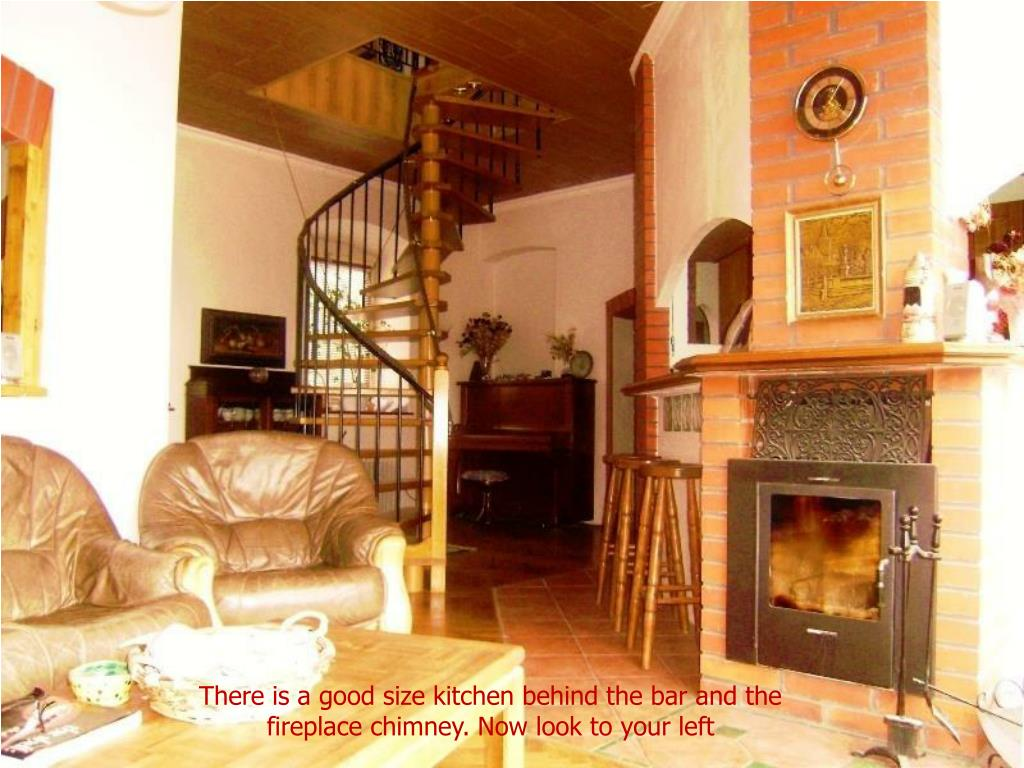 There is a good size kitchen behind the bar and the fireplace chimney. Now look to your left