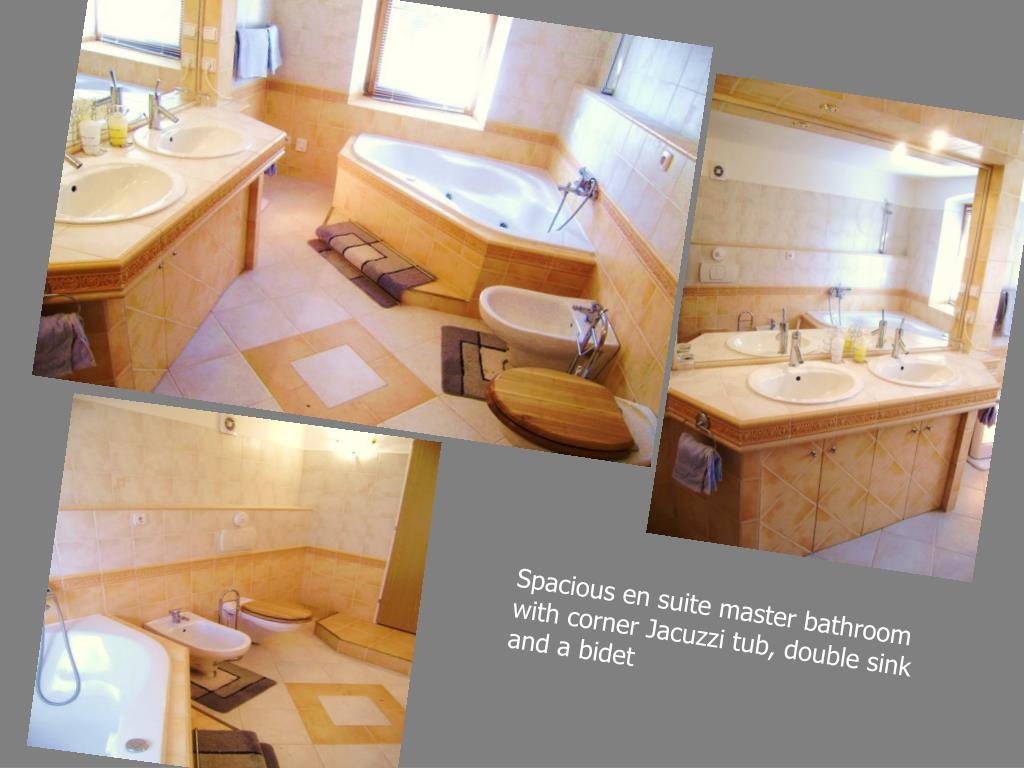 Spacious en suite master bathroom with corner Jacuzzi tub, double sink