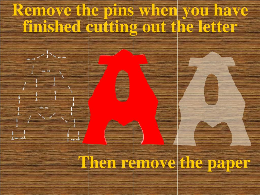 Remove the pins when you have finished cutting out the letter
