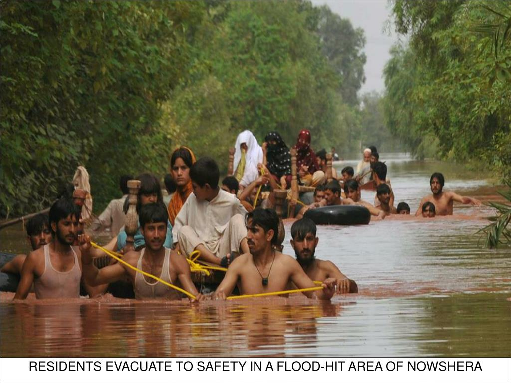 RESIDENTS EVACUATE TO SAFETY IN A FLOOD-HIT AREA OF NOWSHERA