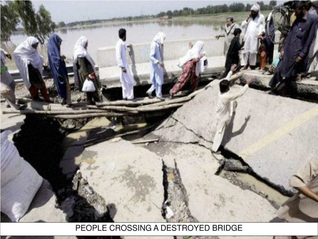 PEOPLE CROSSING A DESTROYED BRIDGE