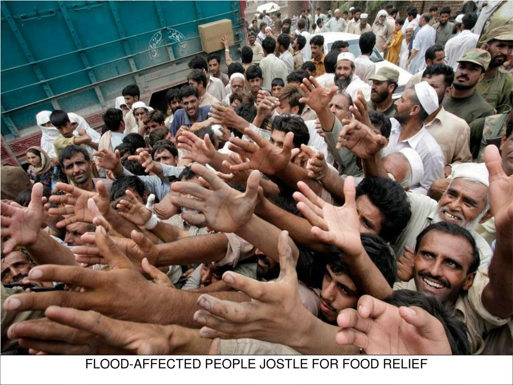 FLOOD-AFFECTED PEOPLE JOSTLE FOR FOOD RELIEF