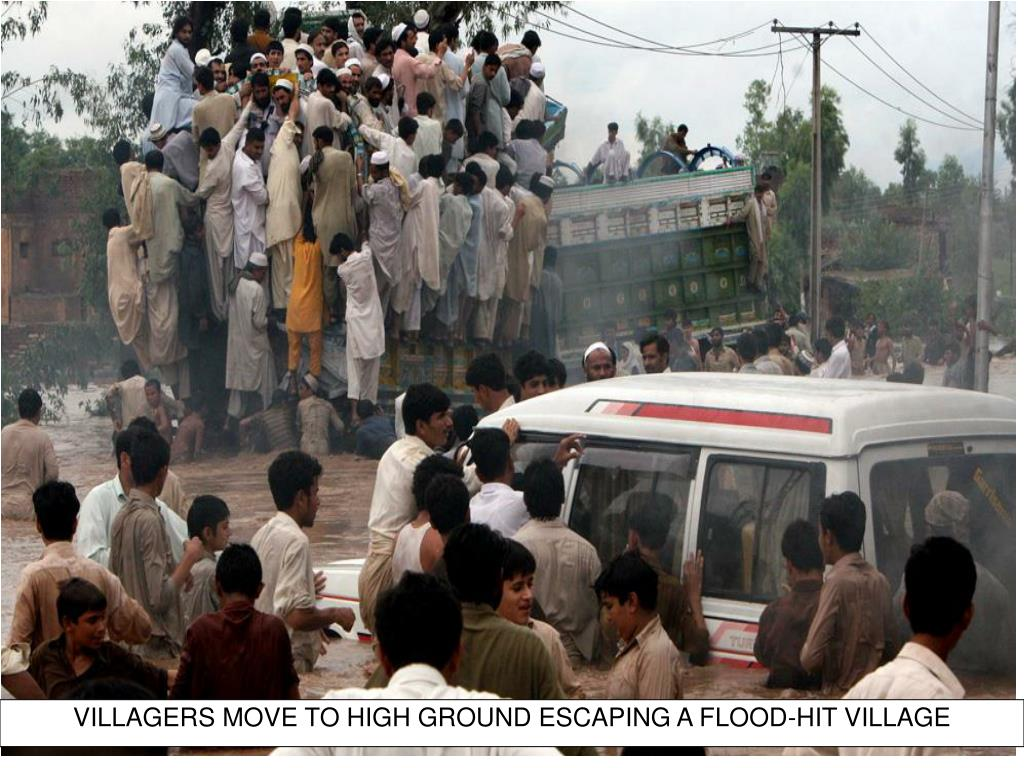 VILLAGERS MOVE TO HIGH GROUND ESCAPING A FLOOD-HIT VILLAGE