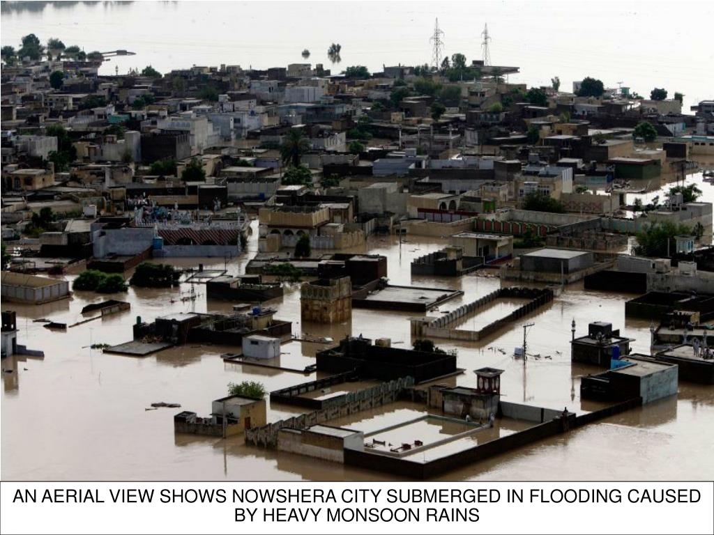 AN AERIAL VIEW SHOWS NOWSHERA CITY SUBMERGED IN FLOODING CAUSED BY HEAVY MONSOON RAINS