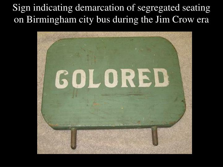 Sign indicating demarcation of segregated seating