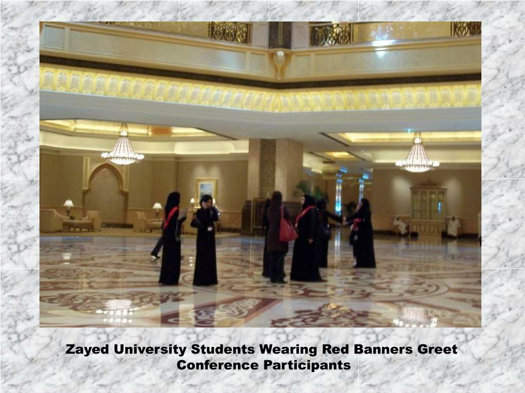 Zayed University Students Wearing Red Banners Greet