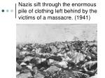 nazis sift through the enormous pile of clothing left behind by the victims of a massacre 1941