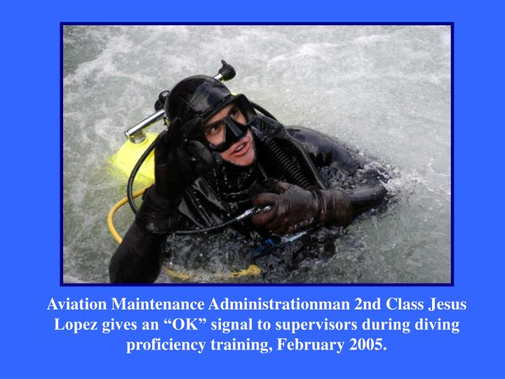 """Aviation Maintenance Administrationman 2nd Class Jesus Lopez gives an """"OK"""" signal to supervisors during diving proficiency training, February 2005."""