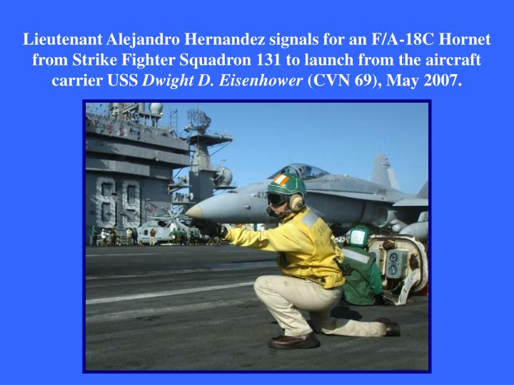 Lieutenant Alejandro Hernandez signals for an F/A-18C Hornet from Strike Fighter Squadron 131 to launch from the aircraft carrier USS