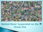 bottled water suspended on the ocean line