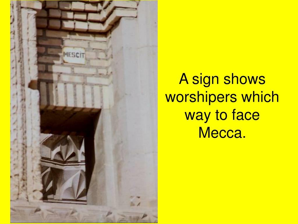 A sign shows worshipers which way to face Mecca.