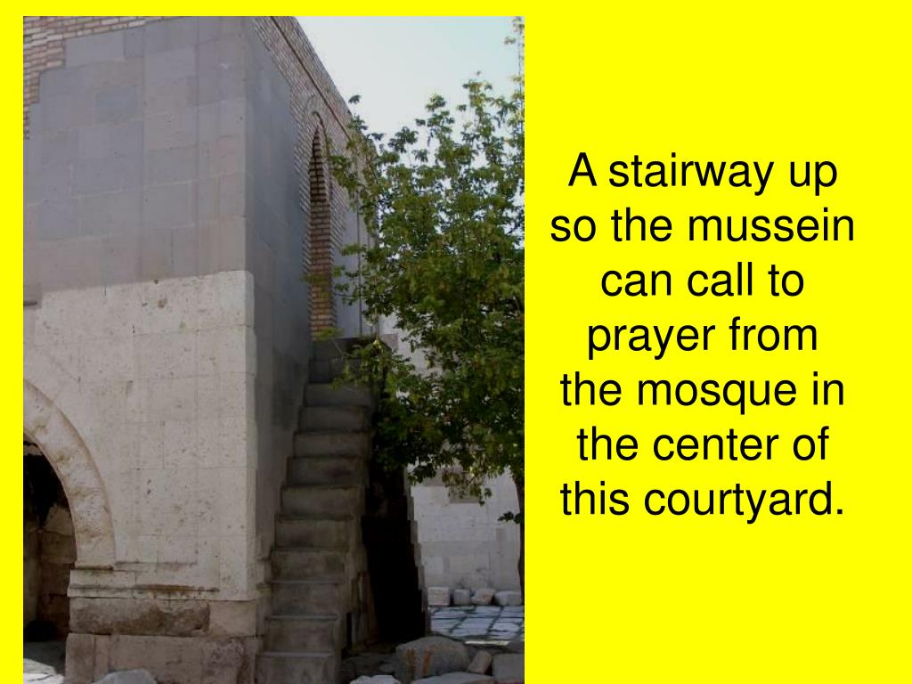 A stairway up so the mussein can call to prayer from the mosque in the center of this courtyard.