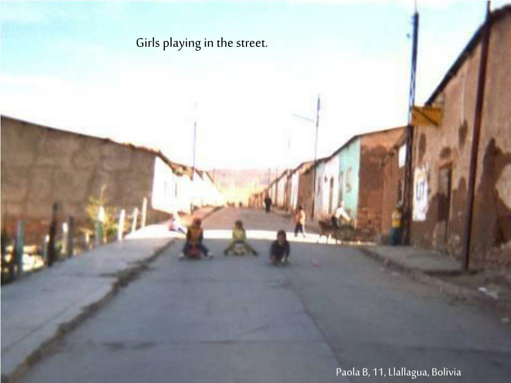 Girls playing in the street.
