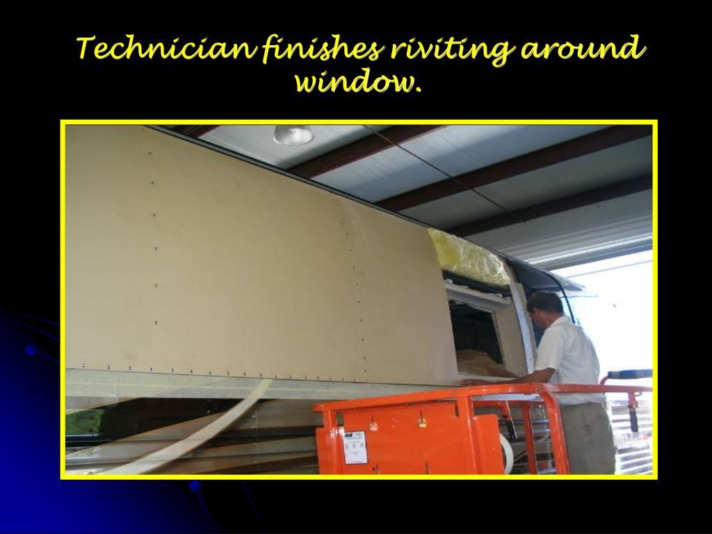 Technician finishes riviting around window.