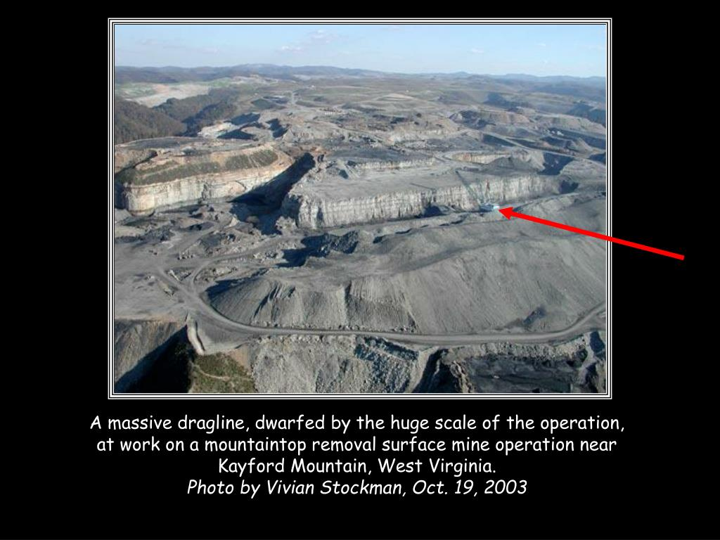 A massive dragline, dwarfed by the huge scale of the operation, at work on a mountaintop removal surface mine operation near Kayford Mountain, West Virginia.