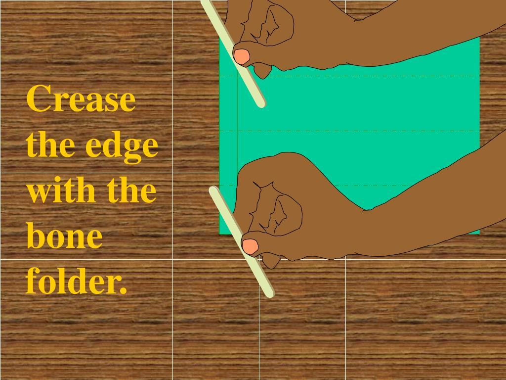 Crease the edge with the bone folder.