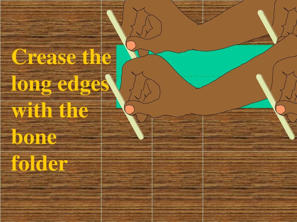 Crease the long edges with the bone folder