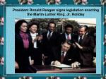 president ronald reagan signs legislation enacting the martin luther king jr holiday