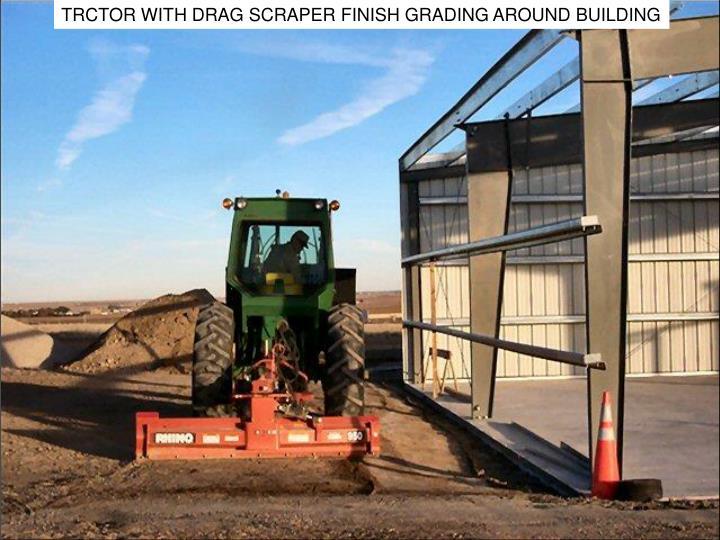 TRCTOR WITH DRAG SCRAPER FINISH GRADING AROUND BUILDING