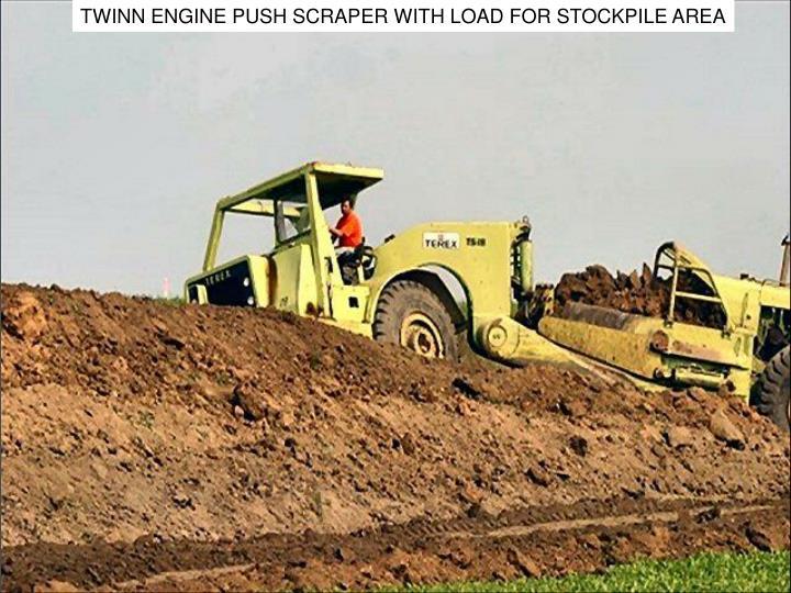 TWINN ENGINE PUSH SCRAPER WITH LOAD FOR STOCKPILE AREA