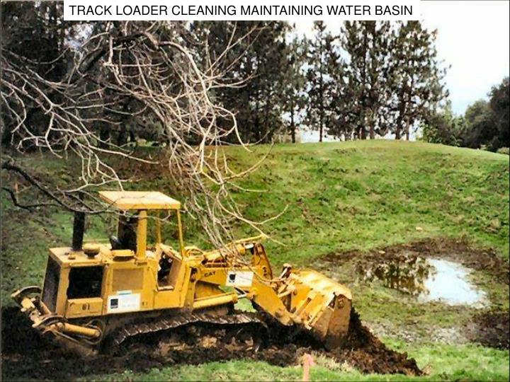TRACK LOADER CLEANING MAINTAINING WATER BASIN