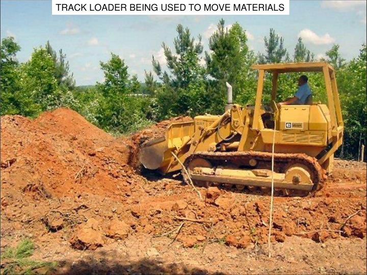 TRACK LOADER BEING USED TO MOVE MATERIALS