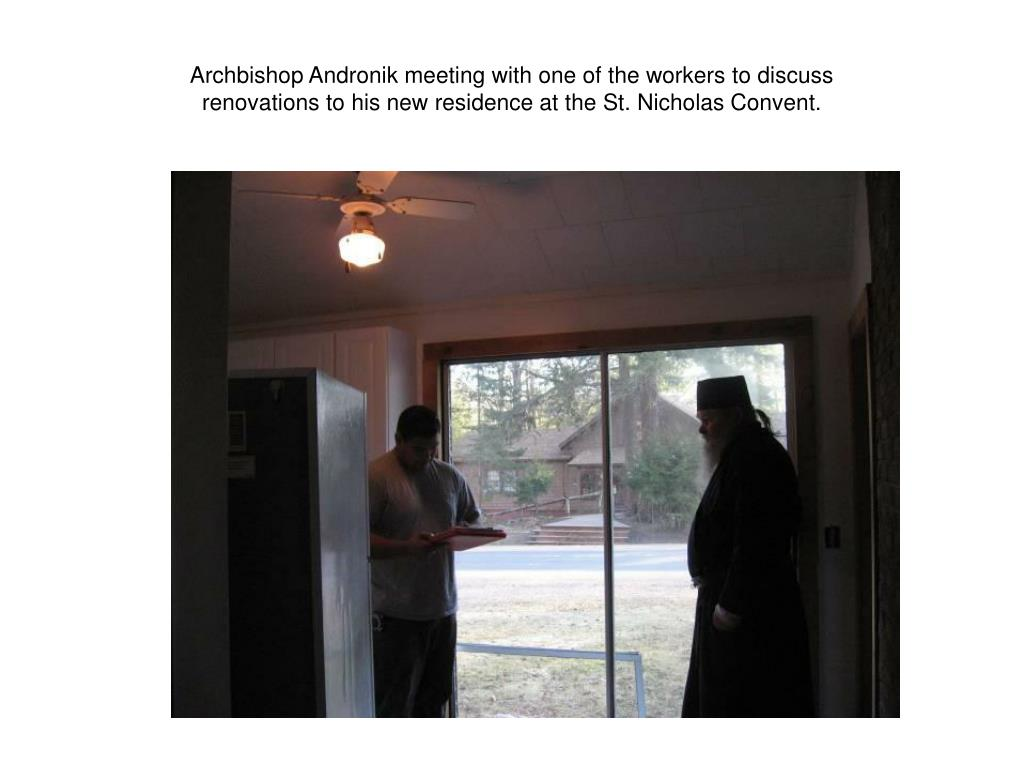 Archbishop Andronik meeting with one of the workers to discuss