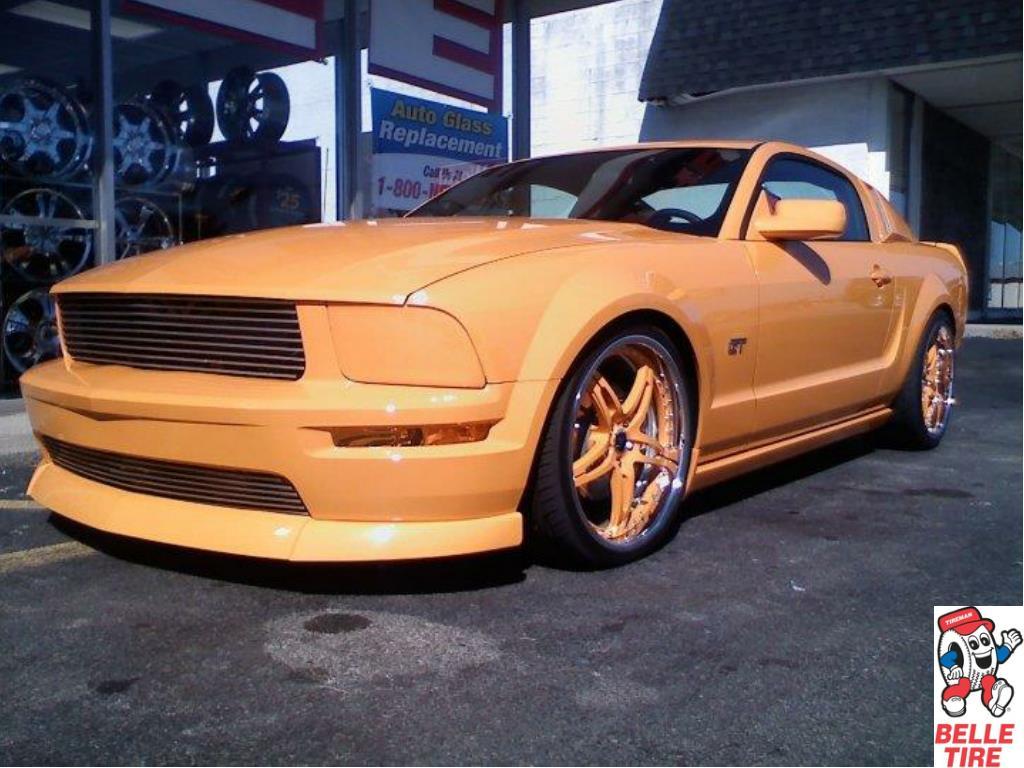 Custom Rims on an Orange Ford Mustang