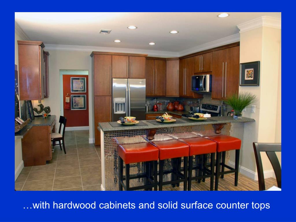 …with hardwood cabinets and solid surface counter tops