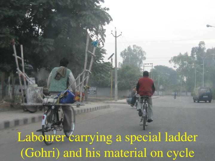 Labourer carrying a special ladder (Gohri) and his material on cycle