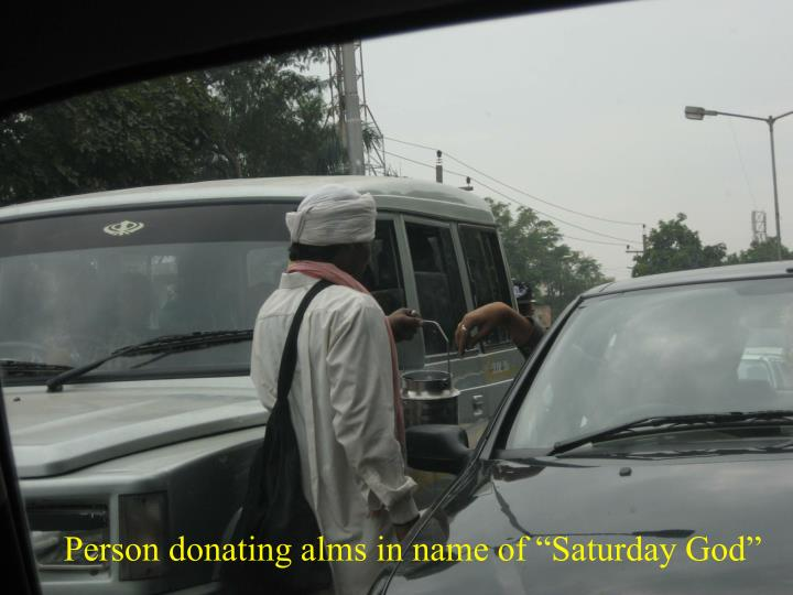 "Person donating alms in name of ""Saturday God"""