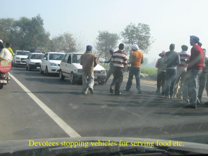 Devotees stopping vehicles for serving food etc.