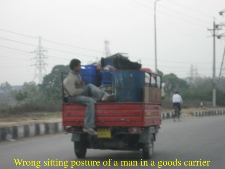 Wrong sitting posture of a man in a goods carrier