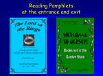 reading pamphlets at the entrance and exit