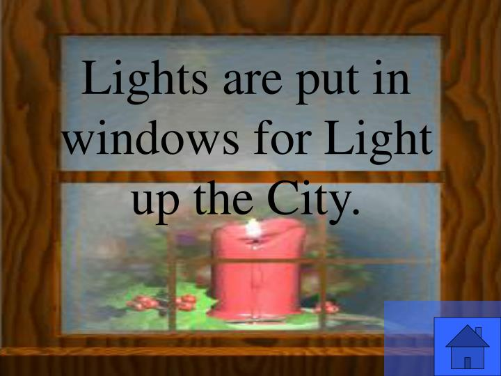 Lights are put in windows for Light up the City.
