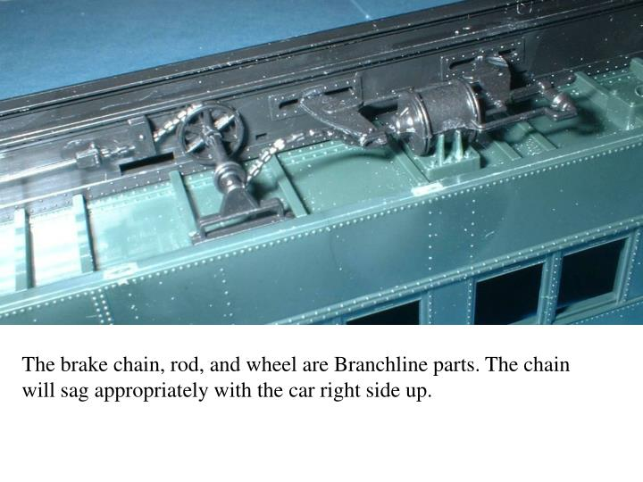 The brake chain, rod, and wheel are Branchline parts. The chain will sag appropriately with the car right side up.