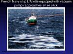 french navy ship l ailette equipped with vacuum pumps approaches an oil slick
