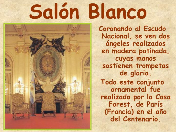 Coronando al Escudo Nacional, se ven dos ángeles realizados en madera patinada, cuyas manos sostienen trompetas de gloria.