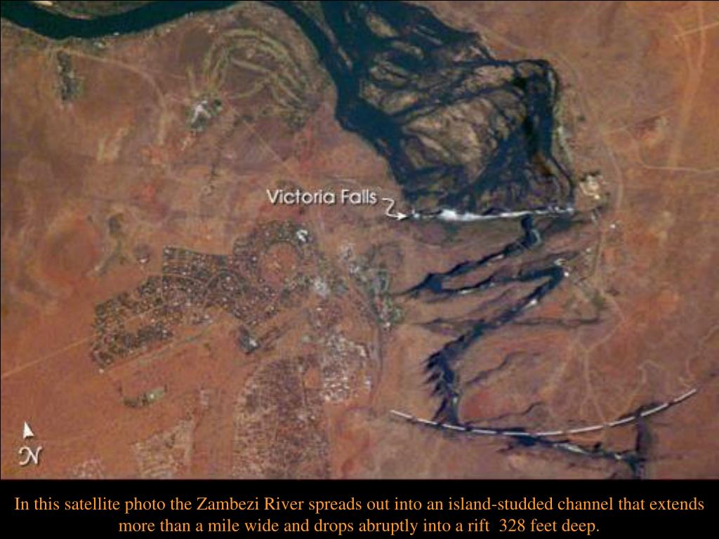 In this satellite photo the Zambezi River spreads out into an island-studded channel that extends  more than a mile wide and drops abruptly into a rift  328 feet deep.