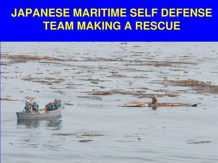 JAPANESE MARITIME SELF DEFENSE TEAM MAKING A RESCUE