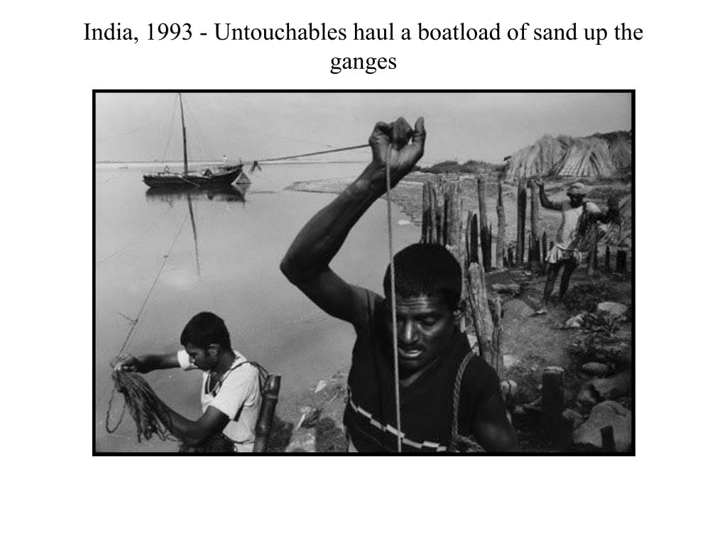 India, 1993 - Untouchables haul a boatload of sand up the ganges